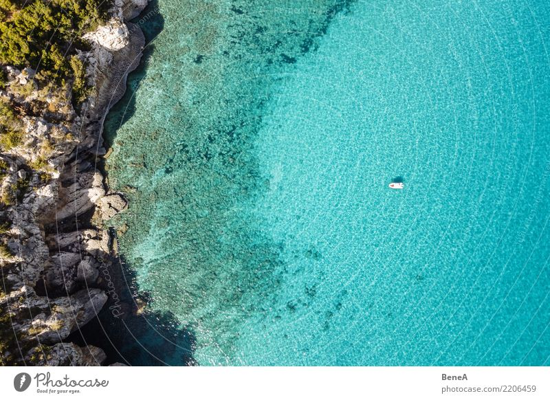 Boat anchors in rocky bay with turquoise blue sea from above Relaxation Swimming & Bathing Vacation & Travel Tourism Trip Adventure Far-off places Freedom