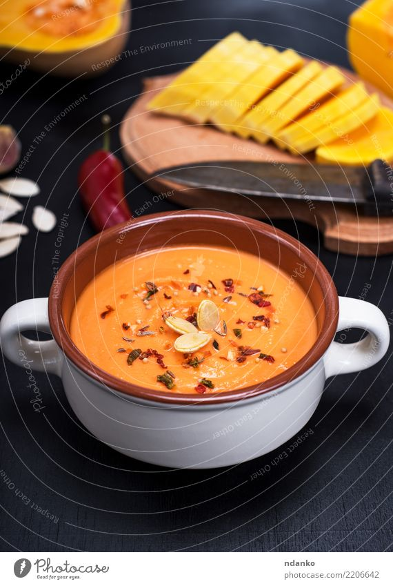 pumpkin soup in a ceramic plate Vegetable Soup Stew Herbs and spices Nutrition Eating Lunch Dinner Organic produce Vegetarian diet Diet Plate Table Hallowe'en