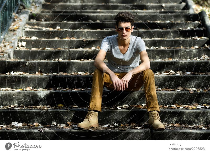 Young man, model of fashion,sitting in urban stairs Human being Man White Eroticism Winter Face Adults Lifestyle Autumn Natural Style Hair and hairstyles
