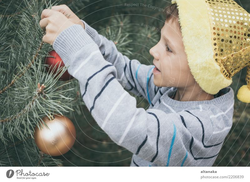 Happy young little boy decorating Christmas tree Child Human being Christmas & Advent Beautiful Tree Hand Joy Winter Face Lifestyle Family & Relations