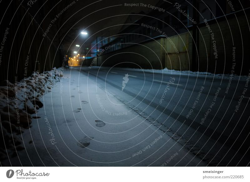 street, cold Winter Ice Frost Snow Industrial plant Street Lanes & trails Dark Cold Loneliness Serene Footprint Street lighting Colour photo Exterior shot