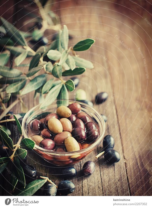 Fresh Olives And Olive Branch On Rustic Wood Background