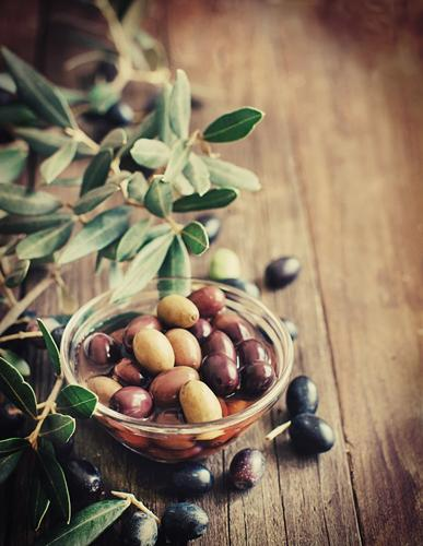Fresh olives and olive branch on rustic wood background Green Leaf Dark Yellow Natural Brown Nutrition Vegetable Harvest Bottle Diet Rustic Ingredients Italian