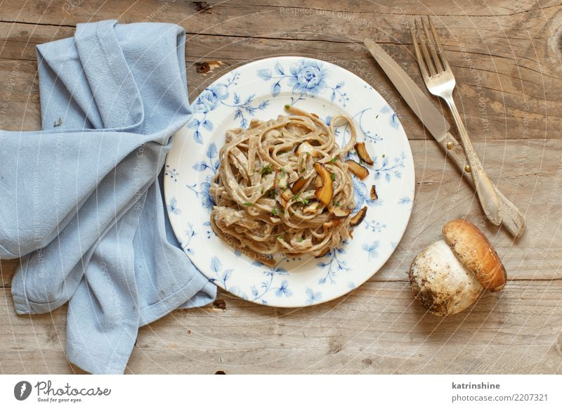 Whole wheat tagliolini with mushrooms Porcini Vegetable Lunch Dinner Vegetarian diet Plate Fresh Delicious Above Yellow White Boletus champignon cream Cooking
