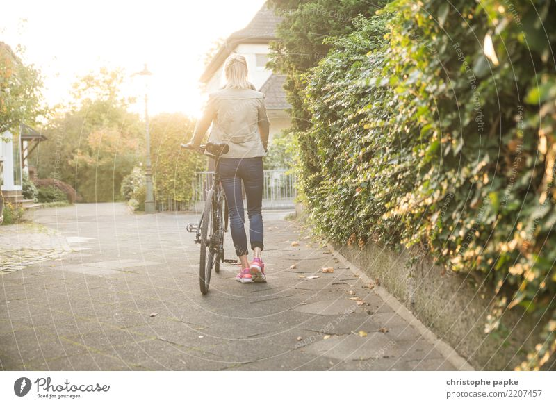 Who loves his bike, pushes it Contentment Cycling Bicycle Woman Adults 1 Human being 30 - 45 years Town Going Bright Push Colour photo Exterior shot