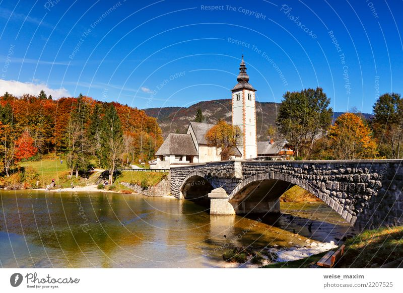 Colorful autumn day in ancient village. Old bridge and church Sky Nature Vacation & Travel Landscape Tree House (Residential Structure) Far-off places Forest