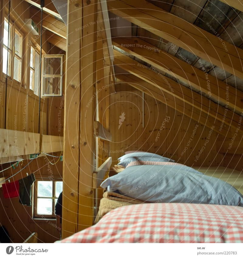 Calm House (Residential Structure) Window Hiking Bed Roof Simple Living or residing Hut Safety (feeling of) Cushion Attic Prop Roof beams Rustic Hostel