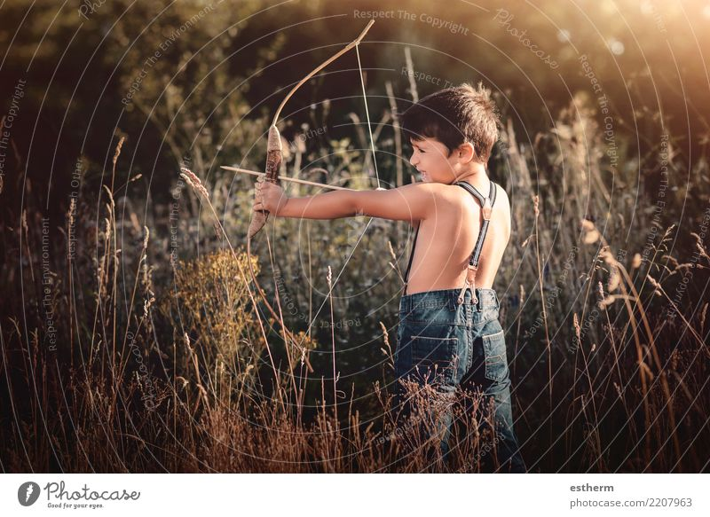 archer boy Child Human being Vacation & Travel Forest Lifestyle Emotions Movement Playing Freedom Leisure and hobbies Masculine Field Infancy Adventure Fitness