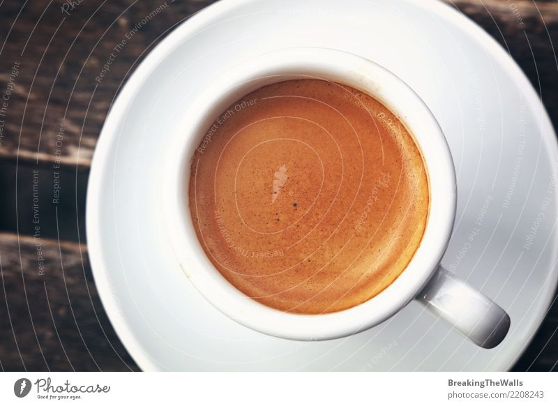 Close up of espresso cup crema directly above White Dark Food Brown Nutrition Retro Esthetic Idea Energy Beverage Coffee Drinking Breakfast Vintage Wooden table