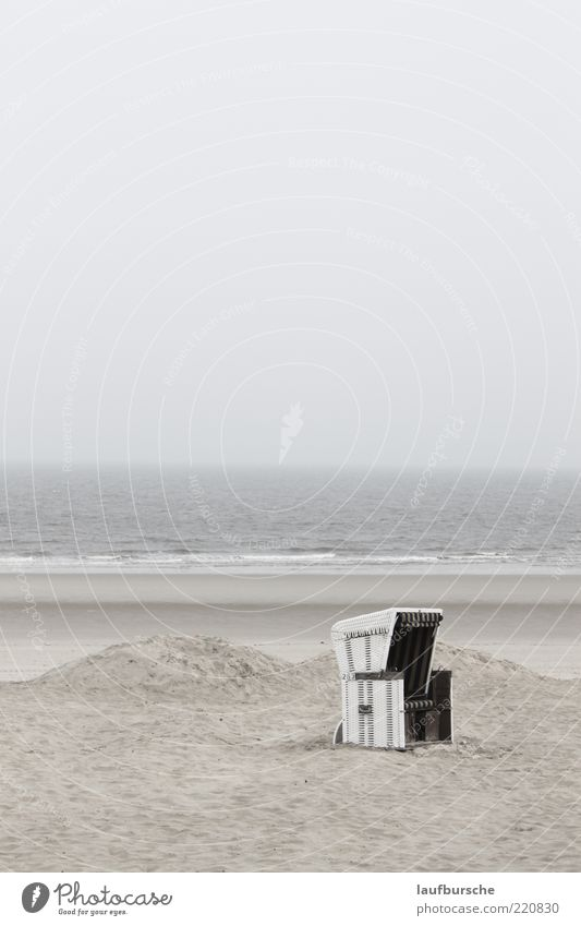 Wellness beach chair on Wangerooge Calm Beach Ocean Island Waves Environment Nature Landscape Sand Water Sky Clouds Weather Fog Subdued colour Exterior shot
