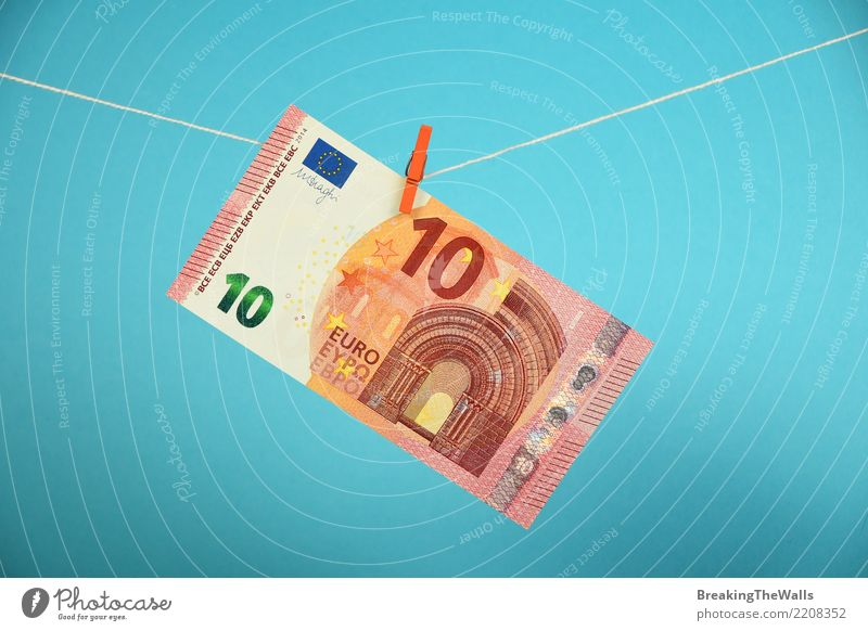 Ten Euro currency banknote hanging over blue Blue Business Europe Threat Rope Money To fall Risk Decline Economy Craft (trade) Hang Trade Washing Crisis