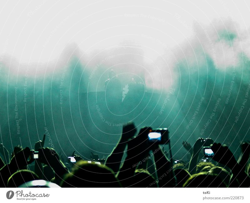 Human being Blue Hand Green White Life Music Feasts & Celebrations Dance Camera Concert Crowd of people Stage Event Fan Take a photo