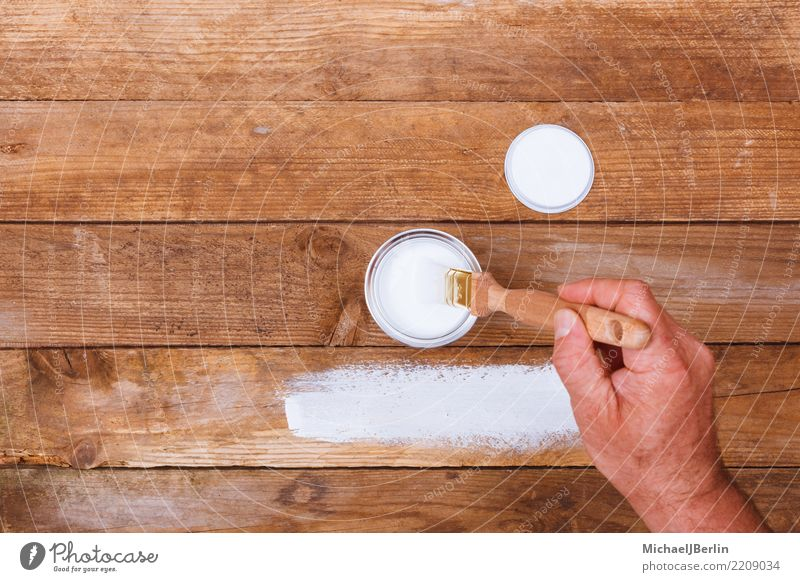 Man varnished a table with white paint Leisure and hobbies Home improvement Furniture Table Construction site Human being Masculine Adults Hand 1 Wood White