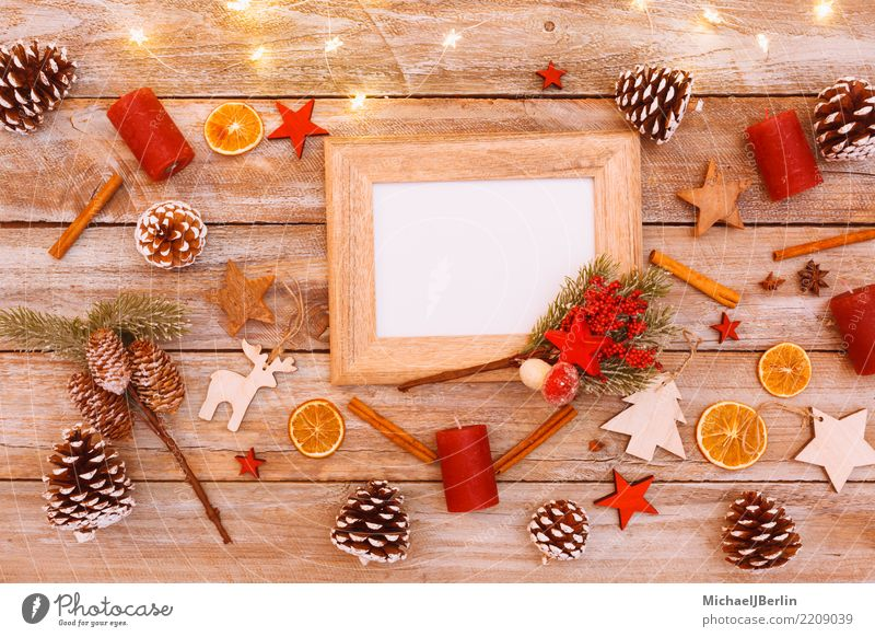 Empty picture frame on Christmas decorated table Winter Christmas & Advent Kitsch Moody Arranged Reindeer Photography Frame Copy Space Table Decoration