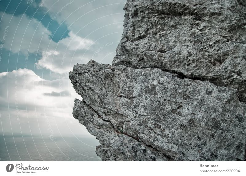 Wind and weather. Ocean Nature Water Sky Clouds Horizon Fog Rock Coast Stone Old Sharp-edged Firm Blue Gray Black Bizarre Crack & Rip & Tear Colour photo