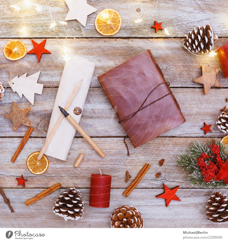 Table with Christmas decoration and food in bird's eye view Winter Christmas & Advent Snowboard Notebook Chaos paper Fame above Arranged branches bright candles