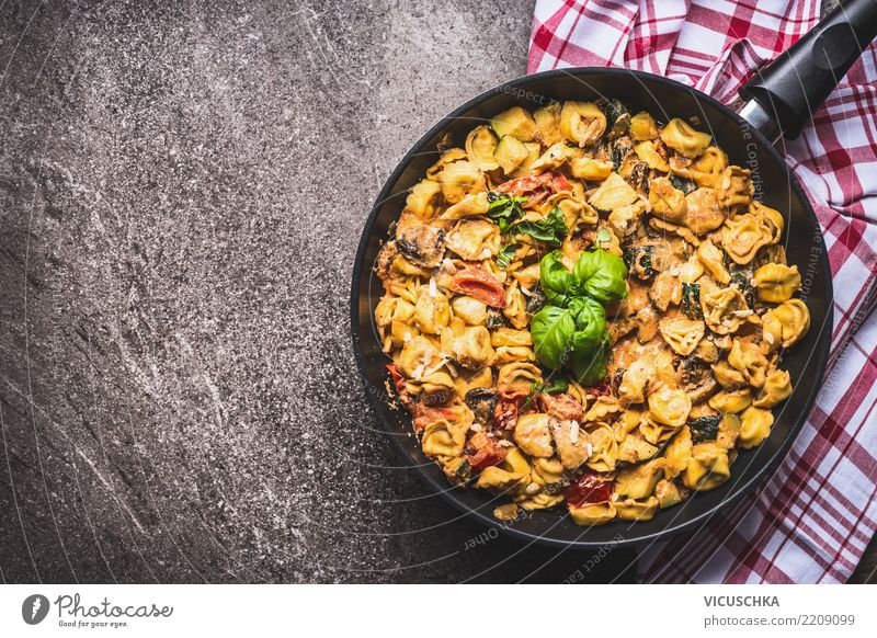 Tortellini pasta with creamy sauce Food Nutrition Lunch Dinner Italian Food Pan Healthy Eating Table Design Style Background picture Ravioli Sauce Vegetable