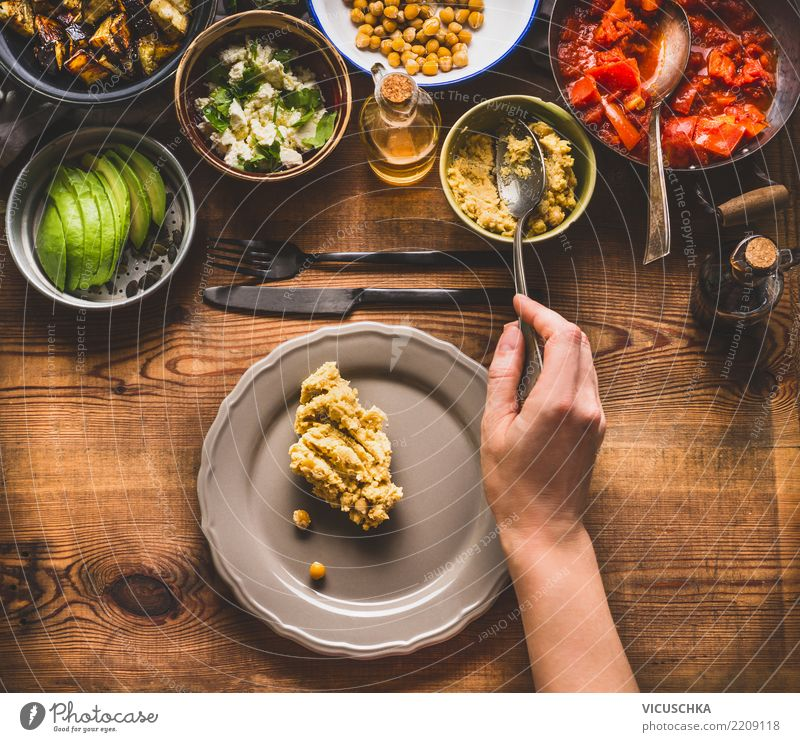 Female hand with spoon brings salad on the plate Food Vegetable Lettuce Salad Grain Herbs and spices Cooking oil Nutrition Lunch Dinner Buffet Brunch