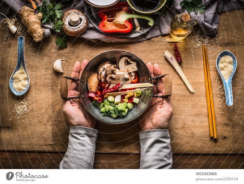 Female hands hold small wok pot with chopped vegetables Food Vegetable Herbs and spices Nutrition Lunch Dinner Banquet Organic produce Vegetarian diet Diet