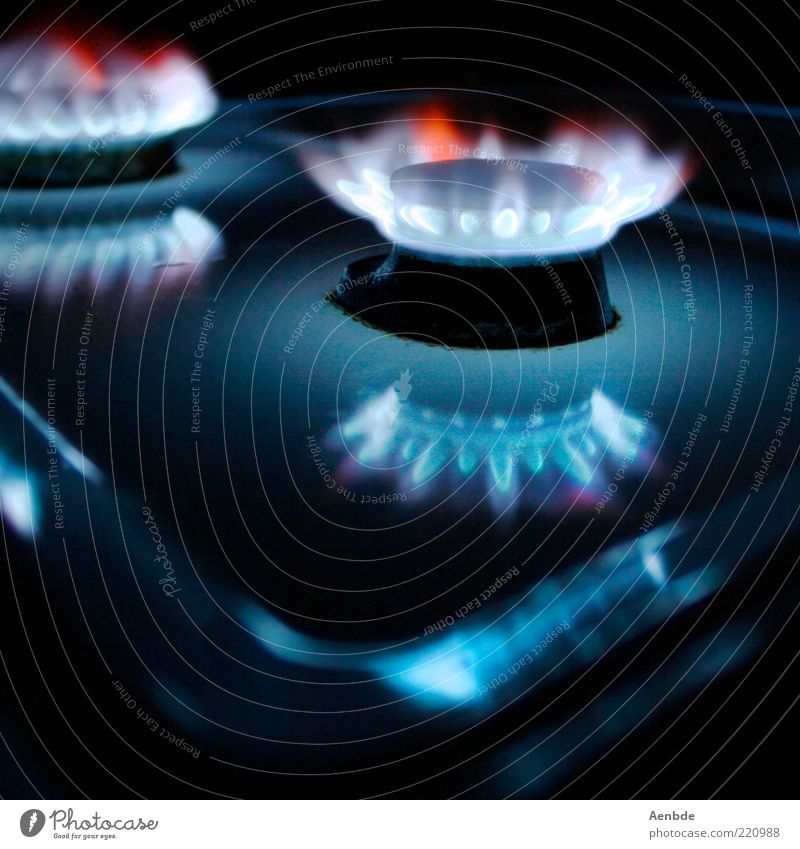 ...ring of fire... Stove & Oven Steel Exceptional Dark Warmth Blue Red Esthetic Gas burner Glint Glow Composing Gas stove Multicoloured Interior shot