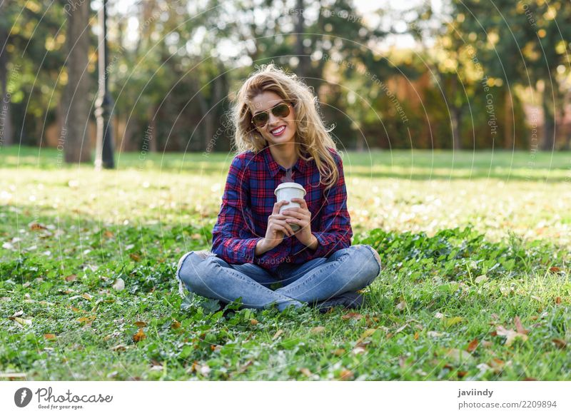 Blonde girl drinking coffee in park sitting on grass Coffee Tea Lifestyle Joy Happy Beautiful Hair and hairstyles Relaxation Human being Woman Adults Nature