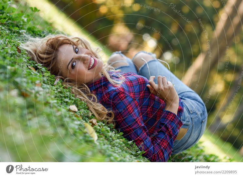Young woman with long blond curly hair laying on grass Woman Human being Nature Youth (Young adults) Beautiful White Relaxation Joy 18 - 30 years Adults