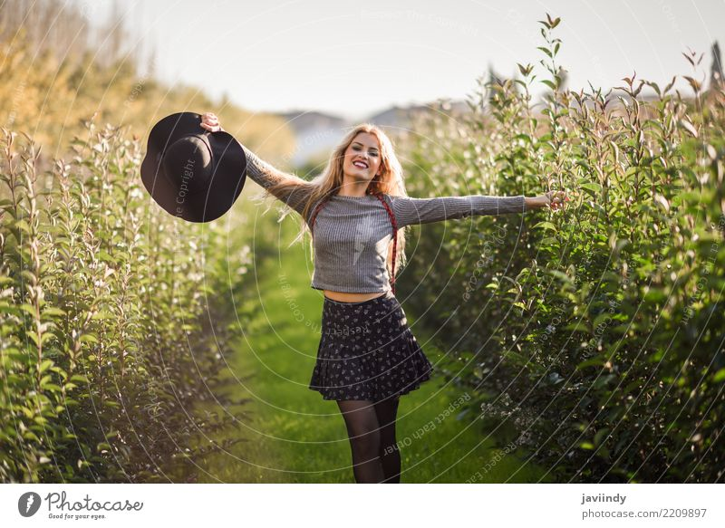 Young woman happy with open arms in rural road Woman Human being Nature Youth (Young adults) Beautiful White Joy 18 - 30 years Adults Autumn Emotions Natural