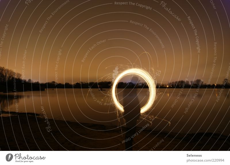 Ring of Fire Human being Environment Nature Landscape Water Sky Night sky Horizon Plant Coast Lakeside River bank Beach Rotate Glittering Illuminate Draw