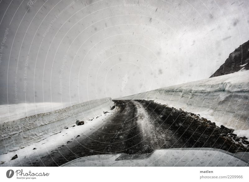 left bend Landscape Clouds Spring Bad weather Snow Snowfall Hill Rock Mountain Driving Car Hood iland Iceland Westfjord Curve Black & white photo Interior shot