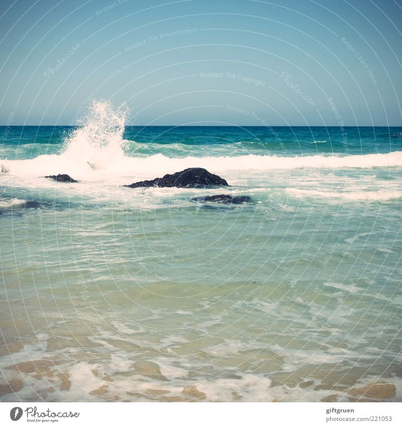 splish splash Environment Nature Elements Water Sky Cloudless sky Horizon Beautiful weather Waves Ocean Blue Pure Natural phenomenon Stone Rock White crest