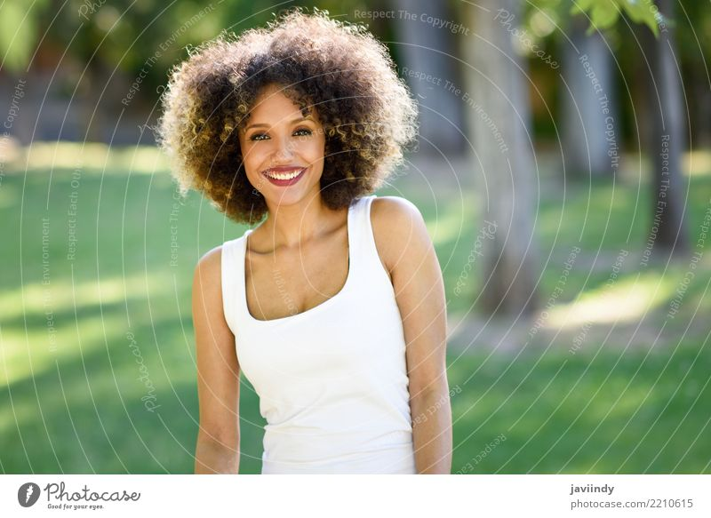 Black woman with afro hairstyle smiling in urban park. Lifestyle Style Happy Beautiful Hair and hairstyles Face Summer Human being Feminine Young woman