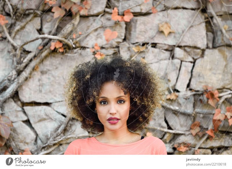 Mixed woman with afro hairstyle standing against a urban wall Lifestyle Style Beautiful Hair and hairstyles Face Human being Feminine Young woman