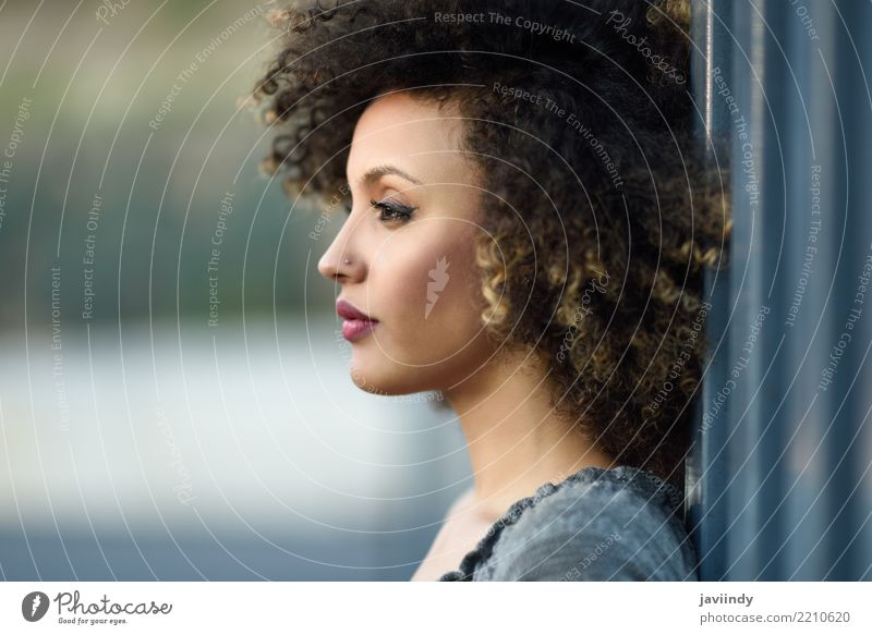 Young mixed woman with afro hairstyle standing in urban background. Lifestyle Style Happy Beautiful Hair and hairstyles Face Human being Woman Adults Street