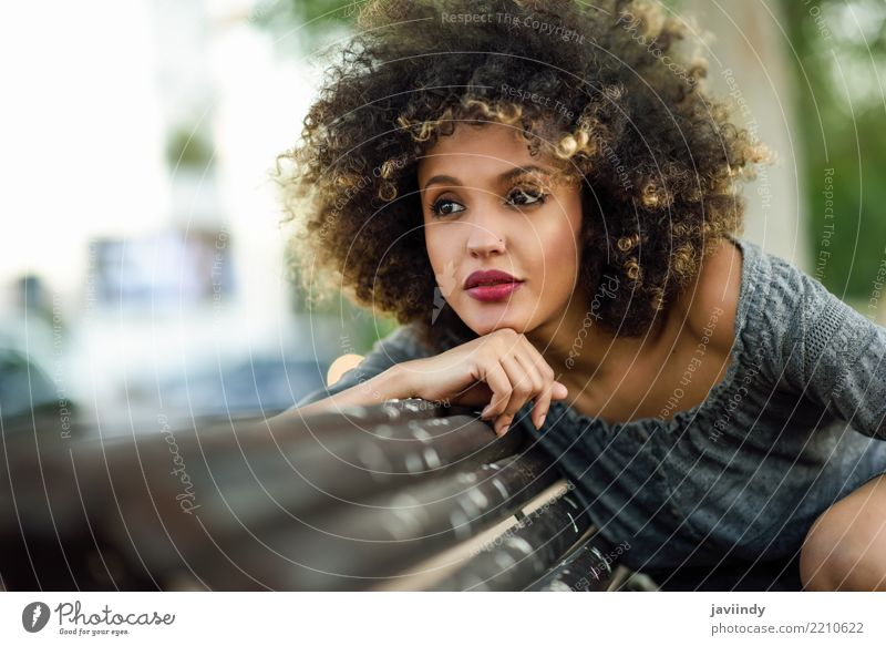Black woman with afro hairstyle sitting on a bench Woman Human being Beautiful Face Adults Street Lifestyle Style Happy Hair and hairstyles Fashion Smiling Cute
