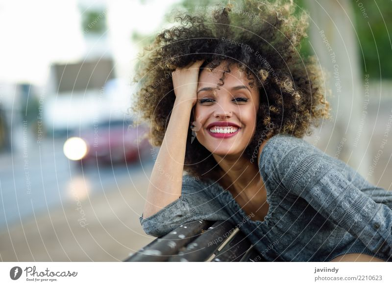 Young mixed woman with afro hairstyle smiling Woman Human being Beautiful Joy Black Face Adults Street Lifestyle Emotions Style Happy Hair and hairstyles