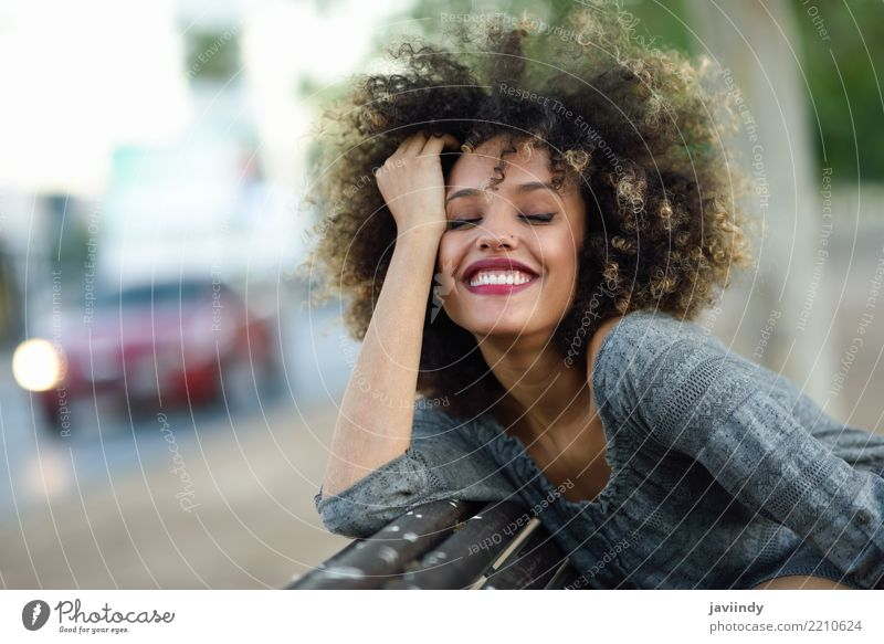 Young black woman with afro hairstyle smiling Lifestyle Style Happy Beautiful Hair and hairstyles Face Human being Woman Adults Street Fashion Afro Smiling Cute