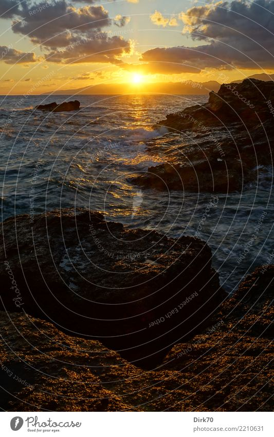 Cretan Sunrise Vacation & Travel Far-off places Freedom Nature Landscape Sky Clouds Sunset Sunlight Beautiful weather Wind Rock Mountain Coast Bay Ocean