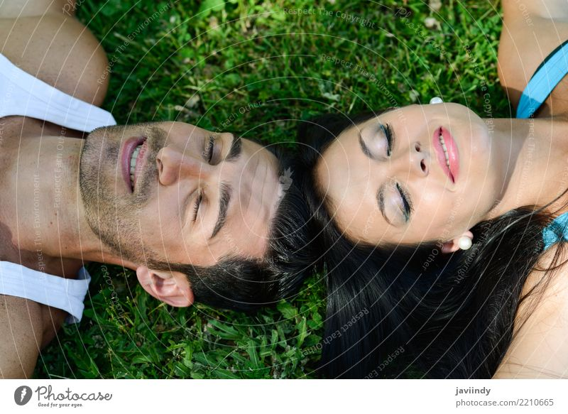 Happy smiling couple laying on green grass Lifestyle Joy Beautiful Relaxation Leisure and hobbies Summer Valentine's Day Human being Woman Adults Man