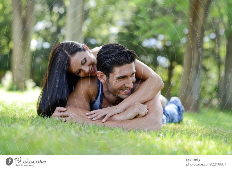 Happy smiling couple laying on green grass Lifestyle Joy Beautiful Relaxation Leisure and hobbies Summer Valentine's Day Woman Adults Man Family & Relations