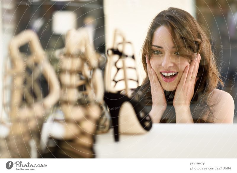Woman looking to showcase or shop window. Human being Summer Beautiful White Joy Adults Street Lifestyle Emotions Style Hair and hairstyles Fashion Footwear