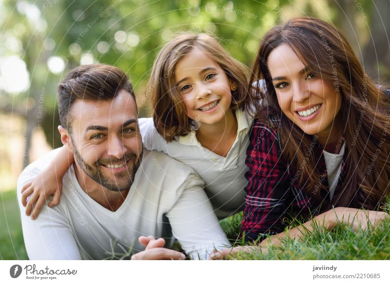 Happy young family in a urban park. Lifestyle Joy Beautiful Summer Child Woman Adults Man Parents Mother Father Family & Relations Infancy Group Nature Autumn