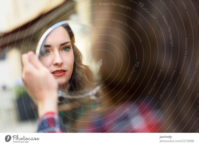 Woman looking at herself in a little mirror in the street Style Beautiful Skin Face Make-up Mirror Human being Adults Street White Beauty Photography young girl