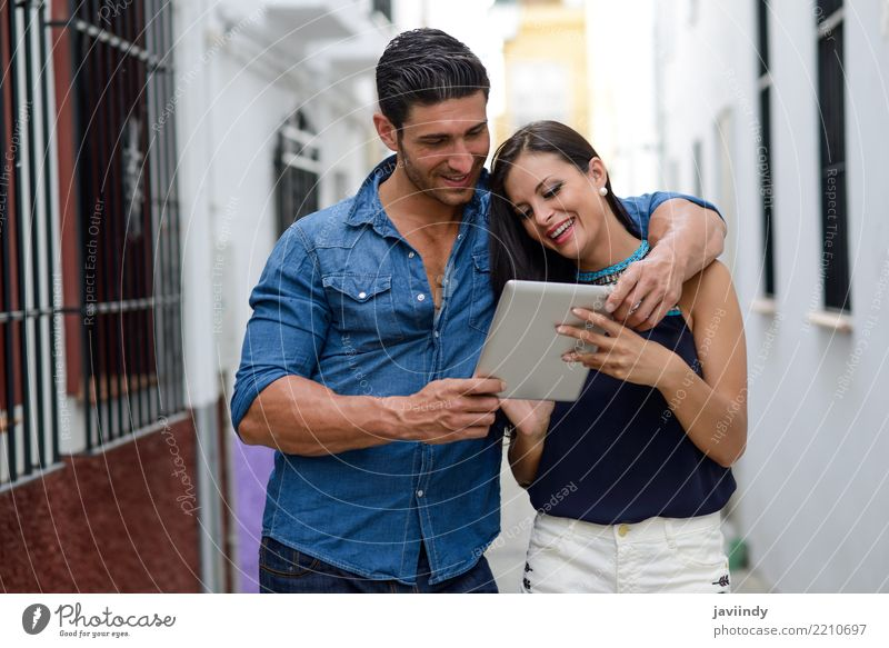 Couple with tablet computer in urban background Woman Human being Man Beautiful Face Adults Lifestyle Love Happy Together Copy Space City life Modern