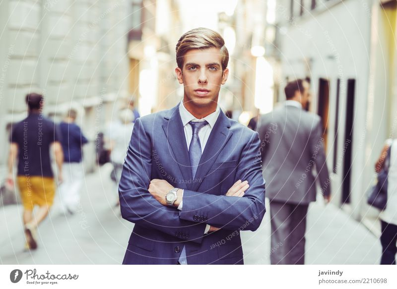 Attractive young businessman in urban background Elegant Style Work and employment Profession Human being Man Adults Fashion Suit Tie Blonde Stand Modern White