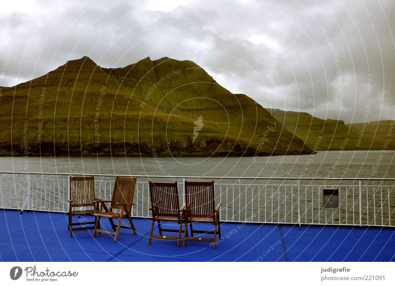 Faroe Islands Vacation & Travel Tourism Far-off places Cruise Ocean Chair Environment Nature Landscape Water Sky Clouds Climate Bad weather Rock Mountain