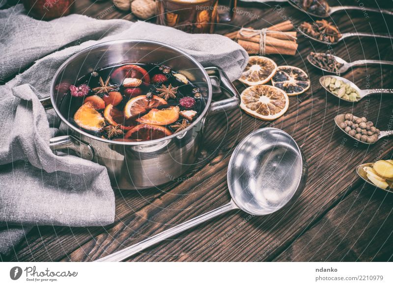 hot mulled wine in a pot with handles Christmas & Advent Winter Dish Wood Feasts & Celebrations Brown Above Orange Table Cooking Herbs and spices Beverage Wine