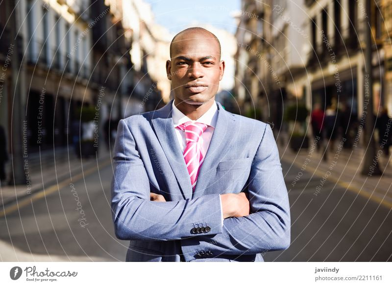 Handsome black man wearing suit in urban background Human being Youth (Young adults) Man Beautiful 18 - 30 years Black Adults Street Happy Business Masculine