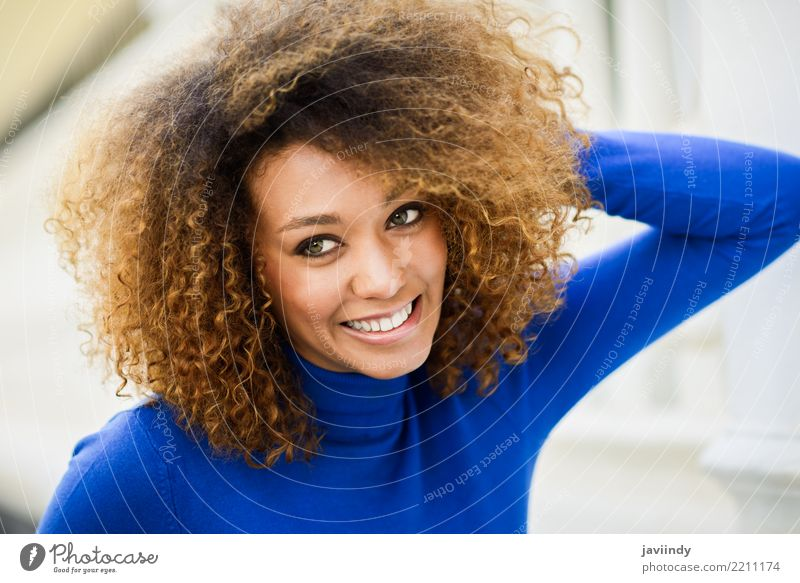 Young woman smiling with afro hairstyle and green eyes Elegant Style Beautiful Hair and hairstyles Face Human being Woman Adults Autumn Fashion Afro Smiling