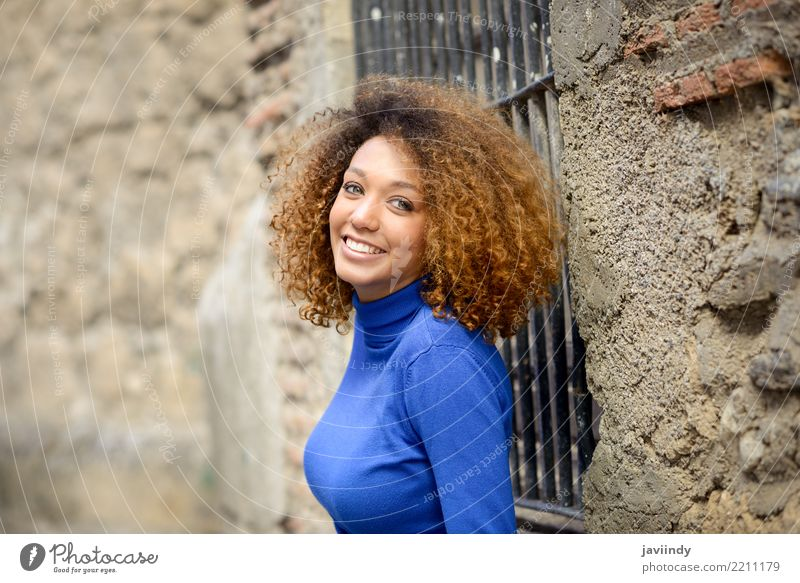 African American woman smiling with afro hairstyle Woman Human being Youth (Young adults) Young woman Beautiful Green 18 - 30 years Black Face Adults Street