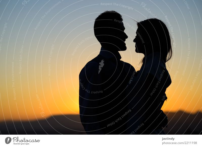 Silhouette of a young bride and groom on Sunset background Happy Beautiful Wedding Human being Woman Adults Man Couple 2 18 - 30 years Youth (Young adults) Sky